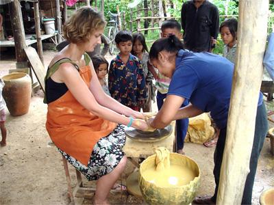 A volunteer makes traditional pottery in Cambodia