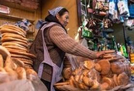 A local entrepreneur selling bread in a Bolivian market