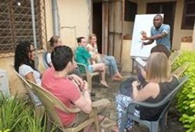 A group of volunteers in Togo attend a Ewe language course class to improve their skills in this local language.