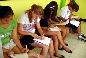 Volunteers make notes during a Patois lesson
