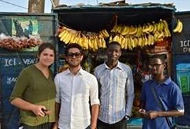 Volunteers practise their newly learned Wolof language skills with local vendors in Senegal.