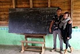 Malagasy language course volunteers pose for a picture following their lesson