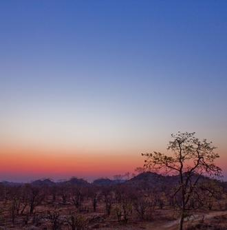Projects Abroad volunteers enjoy a sunset during their free time in Botswana.