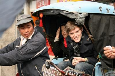 Volunteers travelling in China on public transport
