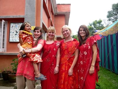 Volunteers in traditional Nepalese clothing
