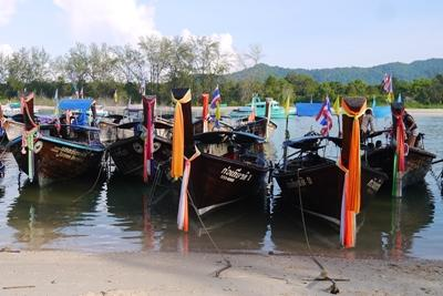 Boats floating on the calm Thailand water