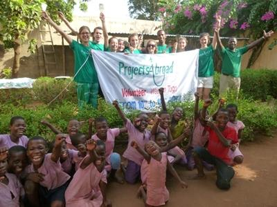 Children and volunteers in Togo during Volunteer Week