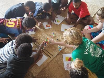 Projects Abroad High School Special volunteers do arts and crafts with children at their Care and Community placement in Fiji