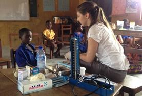 A volunteer works with children during a Public Health discussion on a placement in Ghana
