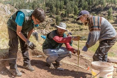 Projects Abroad volunteers on the Incan & Wari Archaeology project log the dimensions of the excavation site in Sacsayhuaman