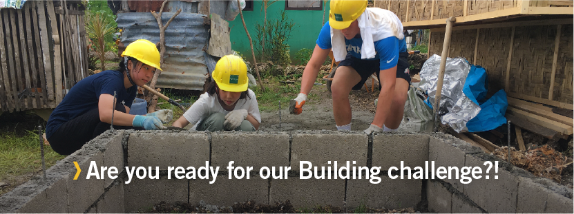 Volunteers from Projects Abroad team up during our construction challenge in the Philippines.