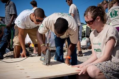 Volunteers help construct a community centre in Cape Town