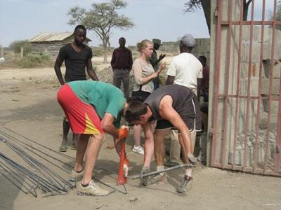Volunteers in Arusha build a nursery school