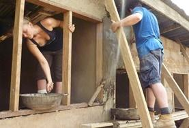 Volunteers work on building the framework for a house being constructed in a local community in Ghana.