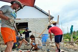 Building volunteers continue with construction work at a placement in the Philippines