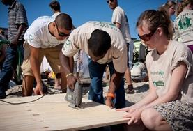 Building volunteers work together to construct a community centre in a local township in South Africa.