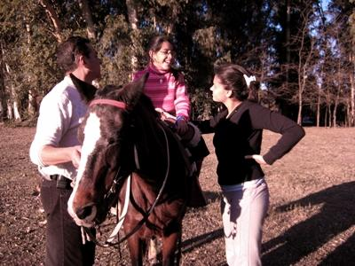 A volunteer helps a child learn how to ride a horse in Argentina