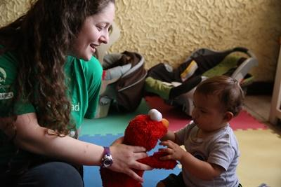 Projects Abroad Care volunteer plays with a child at her placement in Costa Rica