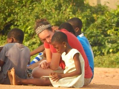Young girl and volunteer read in Ghana
