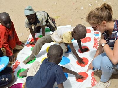 A Belgian Projects Abroad volunteer plays with children at a Care project in Senegal
