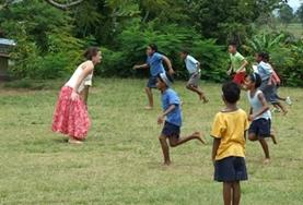 Children play with a volunteer on a Care Project placement in Fiji