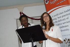 Two Care volunteers give a workshop on HIV/Aids prevention and treatment during an awareness campaign in Jamaica.