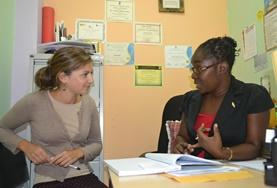 A Psychology student learns from a professional psychologist during her internship in Jamaica.