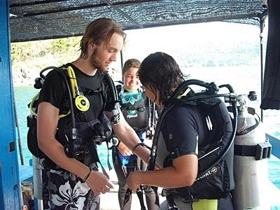 A volunteer on the conservation project in cambodia gets ready to dive in Cambodia