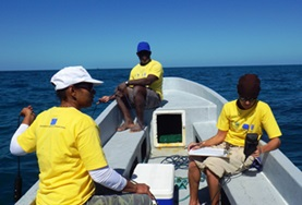 Conservation volunteers pictured on a boat during a marine expedition in Belize