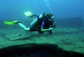 A volunteer scuba dives at a placement