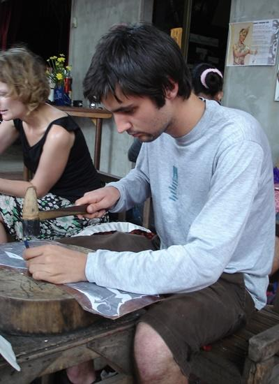 A Khmer project volunteer does metal work in Cambodia