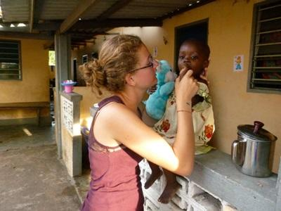 Dentistry volunteer with a Togolese child