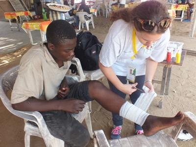 Projects Abroad Nursing Elective volunteers assessing a wound during a medical outreach in Togo