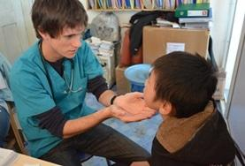 A Nursing Elective volunteers inspects a patient at a placement in Mongolia