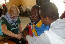 A Nursing student measures a local women's blood pressure as part of her elective work in Tanzania.