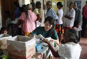 A Pharmacy Elective intern assists with dispensing medicine and treating minor illnesses at a medical outreach in Sri Lanka.