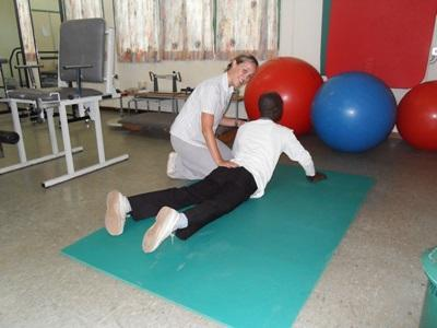 Volunteer on Physiotherapy placement helps a patient in Ghana