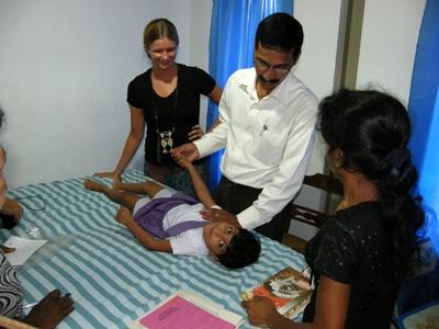 Physiotherapy volunteer in Sri Lanka observes treatment