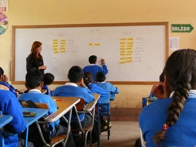 Student participating in a practical English lesson in Peru