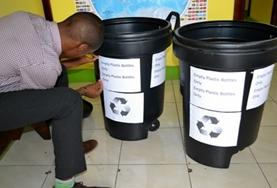 A volunteer labels bins at a placement