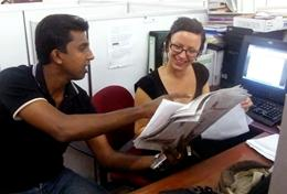 A volunteer learns more about print journalism from a professional journalist during her internship in Sri Lanka.
