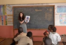 A Human Rights volunteer speaks to local children about their rights during an awareness outreach in Jamaica.