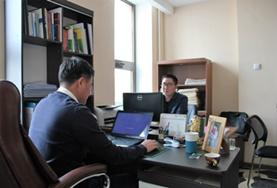 Human Rights voluntees work at their desks at a placement in Mongolia