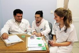 A Medical volunteers speaks to doctors at her placement in Cochabamba