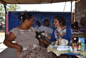 A Pharamcy Project volunteers talks to a local at a placement in Ghana