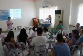 Physiotherapy volunteers attend a meeting at their placement in the Philippines