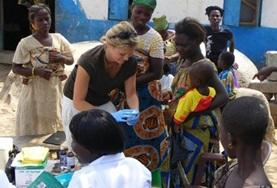 A Public Health volunteer interacts with patients during a community outreach in Ghana