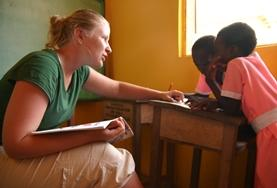 A Speech Therapy intern works closely with two children at our volunteer placement in Ghana.