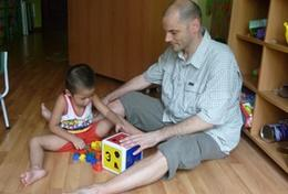 A professional Psychologist works on an activity with a child with autism at a care centre at our volunteer placement in Vietnam.
