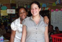 A qualified Midwife holds a baby she helped deliver at her volunteer placement in a Jamaican hospital.
